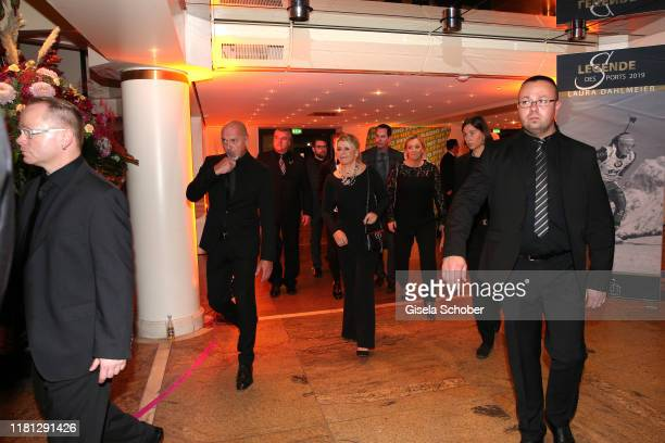 Corinna Schumacher and six bodyguards leave the party during the German Sports Media Ball at Alte Oper on November 9 2019 in Frankfurt am Main Germany