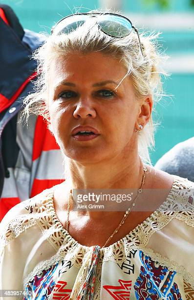 Corinna Schumacher wife of former German Formula One driver Michael Schumacher watches their daughter Gina present the elements of the reining...