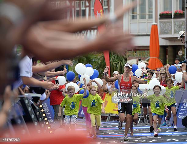 Corinne Abraham of Great Britain celebrates winning the womens race at Ironman Frankfurt on July 6 2014 in Frankfurt am Main Germany
