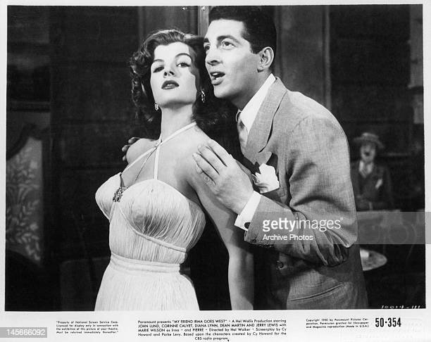 Corinne Calvet leaning back into a singing Dean Martin in a scene from the film 'My Friend Irma Goes West' 1950