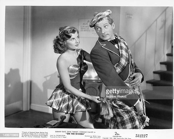 Corinne Calvet tugging at Danny Kaye's kilt in a scene from the film 'On The Riviera' 1951