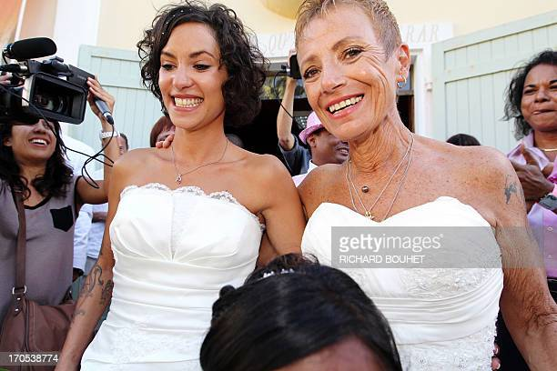 Corinne Denis and Laurence Cerveaux celebrate after being declared married at SaintPaul de la Reunion city hall during the first official gay...