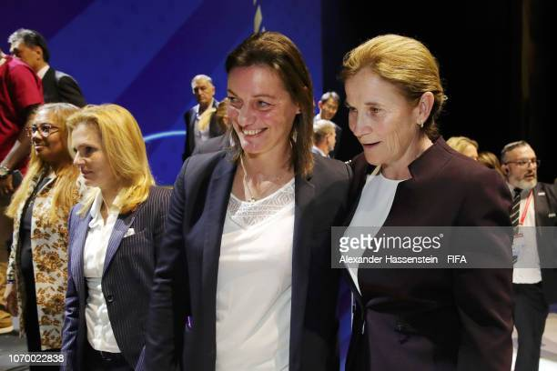 Corinne Diacre coach of France and Jill Ellis coach of the United States talk during the FIFA Women's World Cup France 2019 Draw at La Seine Musicale...