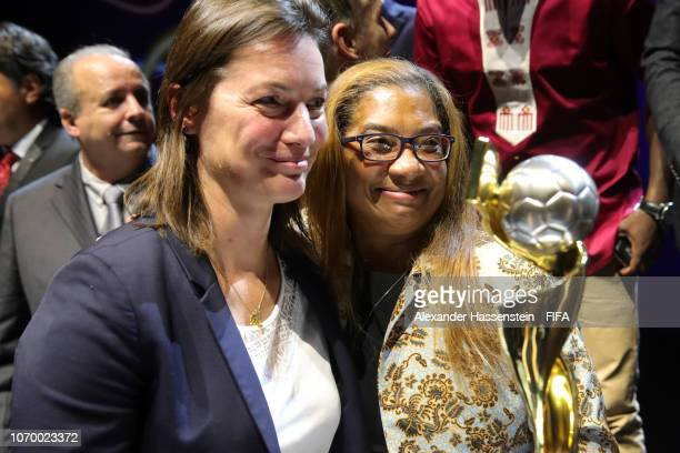 Corinne Diacre coach of France poses with Desiree Ellis coach of South Africa during the FIFA Women's World Cup France 2019 Draw at La Seine Musicale...