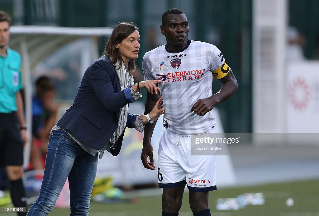 Corinne Diacre, first woman's coach in French professional football, at Clermont Foot Auvergne (Clermont-Ferrand) gives her instructions to her captain Eugene Ekobo during the french Ligue 2 match between La Berrichonne de Chateauroux and Clermont Foot Auvergne at Stade Gaston-Petit on August 15, 2014 in Chateauroux, France.