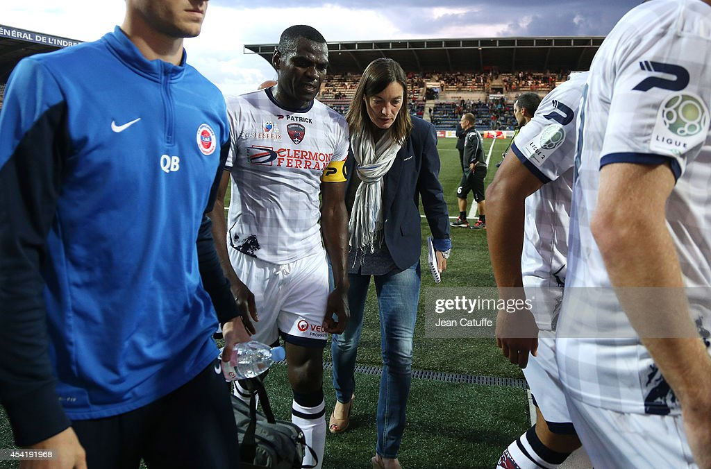 Corinne Diacre, first woman's coach in French professional football, at Clermont Foot Auvergne (Clermont-Ferrand) talks to her captain Eugene Ekobo at half time of the french Ligue 2 match between La Berrichonne de Chateauroux and Clermont Foot Auvergne at Stade Gaston-Petit on August 15, 2014 in Chateauroux, France.