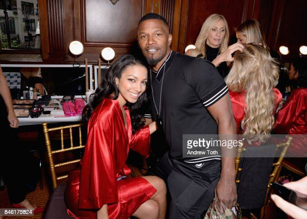 Corinne Foxx and Jamie Foxx pose backstage at the Sherri Hill NYFW SS18 fashion show at Gotham Hall on September 12 2017 in New York City
