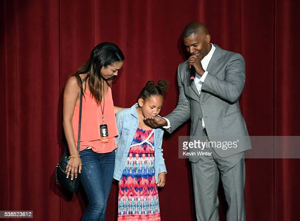 Corinne Foxx Annalise Bishop and Jamie Foxx speak onstage during the Hillary Clinton She's With Us concert at The Greek Theatre on June 6 2016 in Los...