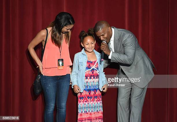Corinne Foxx Annalise Bishop and Jamie Foxx speak onstage during the 'Hillary Clinton She's With Us' concert at The Greek Theatre on June 6 2016 in...