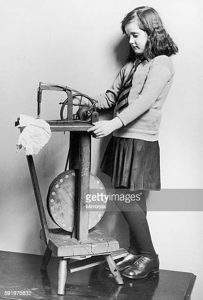 Corinne Griffith seen here in the role of Mary Boyne sitting working at a Singer sewing machine in the film The Unknown Quantity Circa 1919