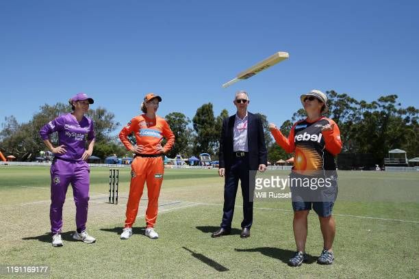 Corinne Hall of the Hurricanes and Meg Lanning of the Scorchers look on at the bat toss during the Women's Big Bash League match between the Hobart...