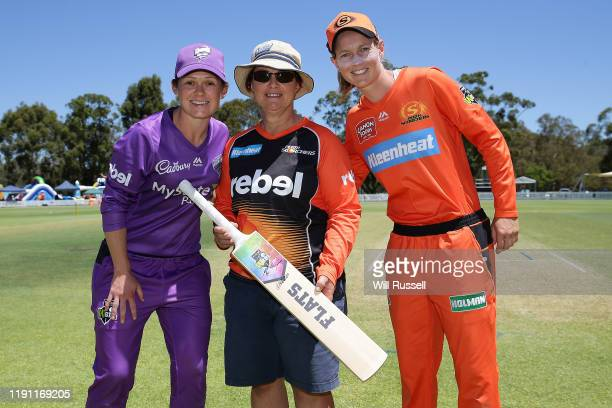 Corinne Hall of the Hurricanes and Meg Lanning of the Scorchers pose after the bat toss during the Women's Big Bash League match between the Hobart...