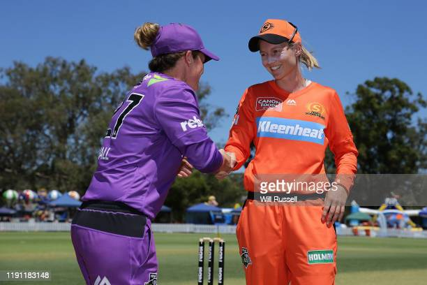 Corinne Hall of the Hurricanes and Meg Lanning of the Scorchers shake hands at the bat toss during the Women's Big Bash League match between the...