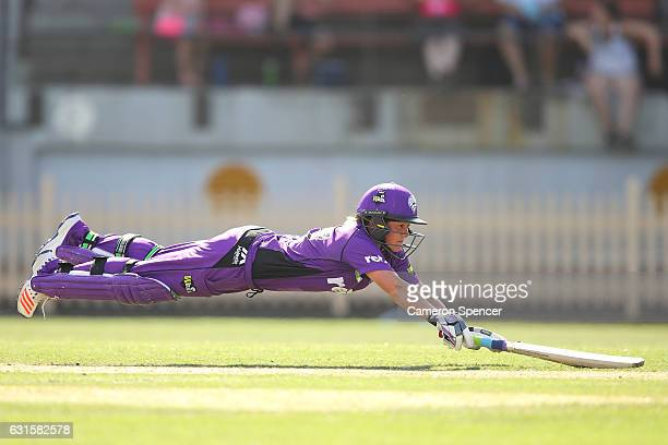 Corinne Hall of the Hurricanes dives for the crease to avoid a run out during the Women's Big Bash League match between the Hobart Hurricanes and the...