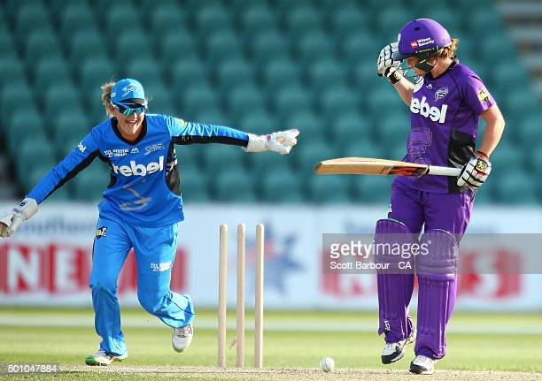 Corinne Hall of the Hurricanes is bowled out as wicketkeeper Sarah Taylor of the Strikers looks on during the Women's Big Bash League match between...