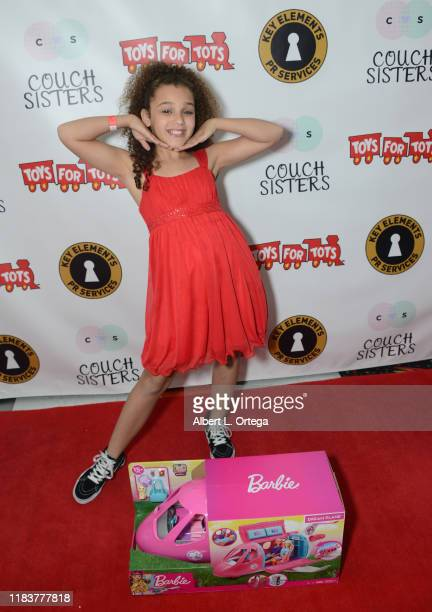 Corinne Joy attends The Couch Sisters 1st Annual Toys For Tots Toy Drive held onNovember 20 2019 in Glendale California