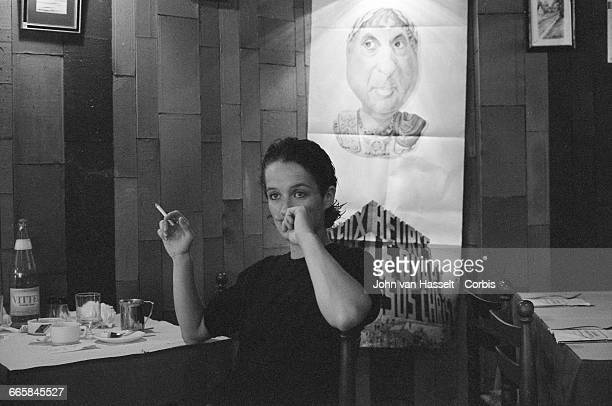 Corinne Marienneau in a cafe while on tour with French rock group Telephone France October 01 1982
