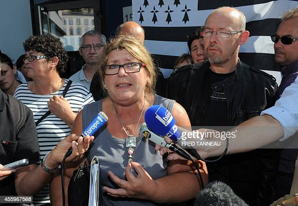 Corinne Nicole union representative of French poultry firm TillySabco talks to the press on September 23 2014 in Brest western of France The firm has...
