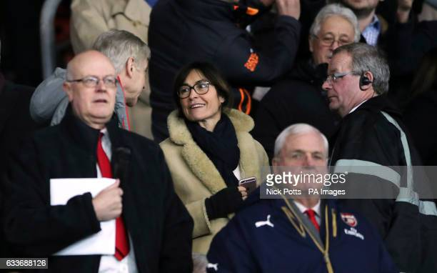 Corinne Puel wife of Southampton manager Claude Puel talks to Arsenal manager Arsene Wenger in the stands