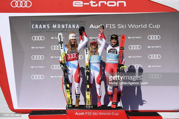 Corinne Suter of Switzerland takes 2nd place Lara Gutbehrami of Switzerland takes 1st place Stephanie Venier of Austria takes 3rd place during the...