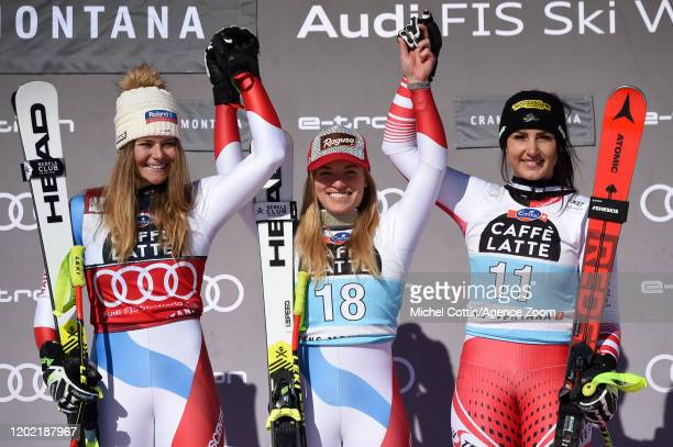 Corinne Suter of Switzerland takes 2nd place, Lara Gut-behrami of Switzerland takes 1st place, Stephanie Venier of Austria takes 3rd place during the...