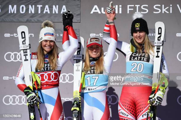 Corinne Suter of Switzerland takes 2nd place, Lara Gut-behrami of Switzerland takes 1st place, Nina Ortlieb of Austria takes 3rd place during the...