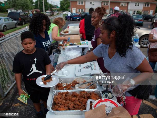 Corinthian Baptist Church members help tornado victims in Dayton Ohio on May 28 after powerful tornadoes ripped through the US state overnight...