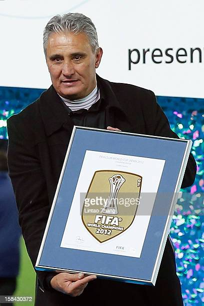 Corinthians caoch Tite poses with the FIFA Club World Cup champions badge after his team won the FIFA Club World Cup Final Match between Corinthians...