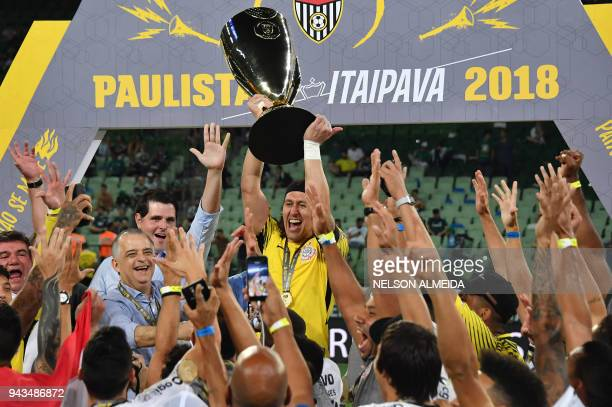Corinthians captain Cassio holds the Paulista championship Cup after winning the final match against Palmeiras held at Allianz Parque stadium in Sao...