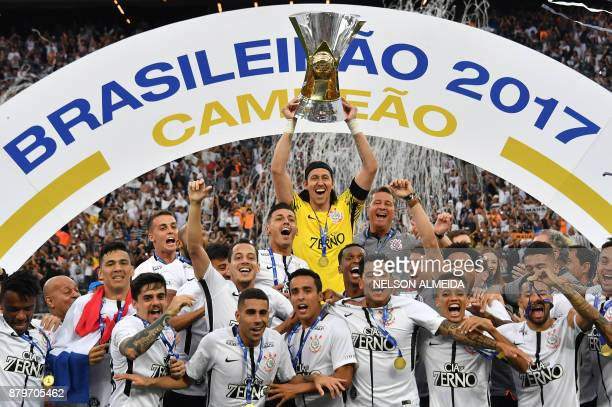 Corinthians' captain Cassio holds the trophy after the team defeats Atletico Mineiro and wins the Brazilian championship at Arena Corinthians stadium...