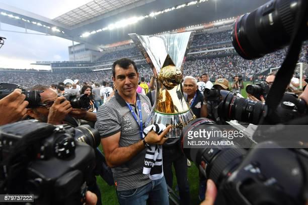 Corinthians coach Fabio Carille celebrates after the team defeats Atletico Mineiro and wins the Brazilian championship at the Arena Corinthians...