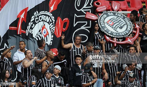Corinthians' fans celebrates after their team scored the second goal against Botafogo during a Brazilian Championship football match at the Joao...