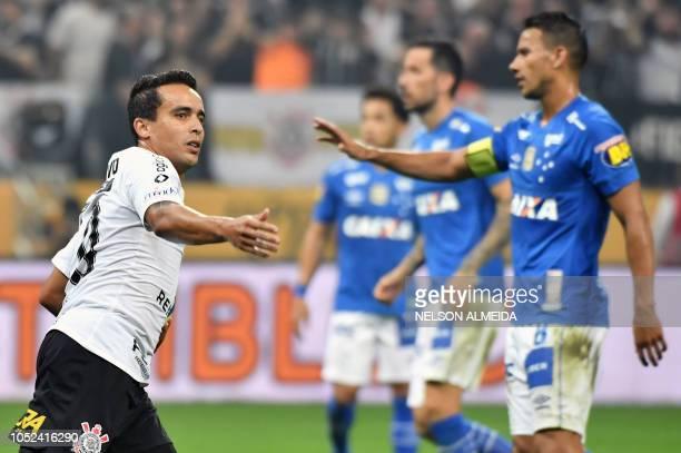 Corinthians' Jadson celebrates his goal against Cruzeiro during their Brazil's Cup final football match at the Arena Corinthians stadium in Sao Paulo...