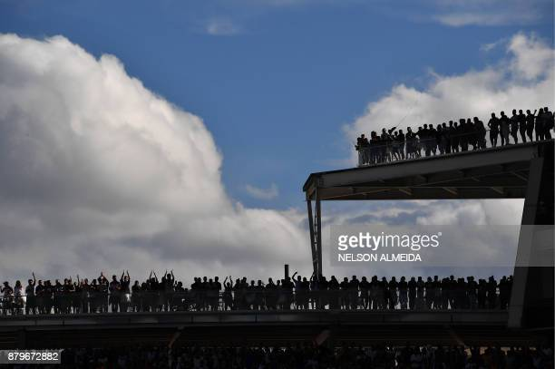 TOPSHOT Corinthians' supporters cheer their team during their Brazilian Championship football match against Atletico Mineiro at the Arena Corinthians...