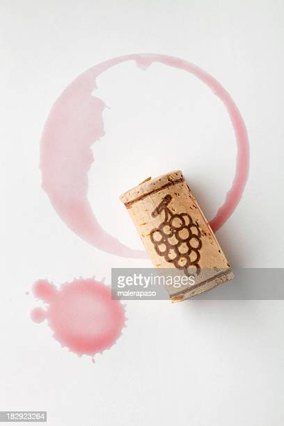 cork and red wine stain - bottle stopper stock photos and pictures