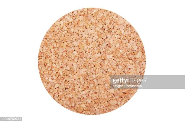 cork coaster isolated on white background - cork material stock pictures, royalty-free photos & images
