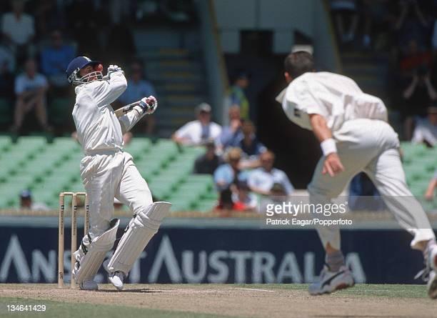 Cork gets ball stuck in helmet from Fleming Australia v England 2nd Test Perth Nov 98