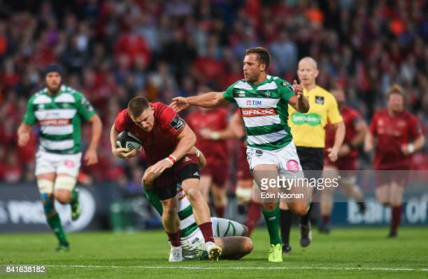 Cork Ireland 1 September 2017 Andrew Conway of Munster is tackled by Ian McKinley of Benetton during the Guinness PRO14 Round 1 match between Munster...