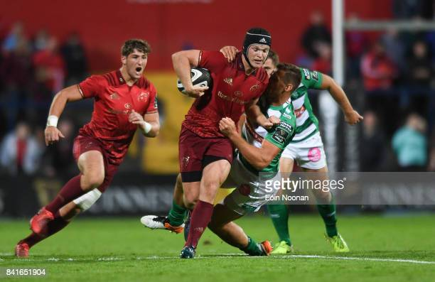Cork Ireland 1 September 2017 Tyler Bleyendaal of Munster is tackled by Alberto Sgarbi of Benetton during the Guinness PRO14 Round 1 match between...