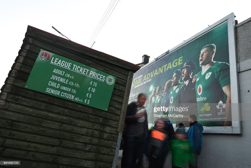 Cork , Ireland - 12 March 2018; Supporters make their way to the game past rugby advertising prior to the SSE Airtricity League Premier Division match between Cork City and Shamrock Rovers at Turner's Cross in Cork.