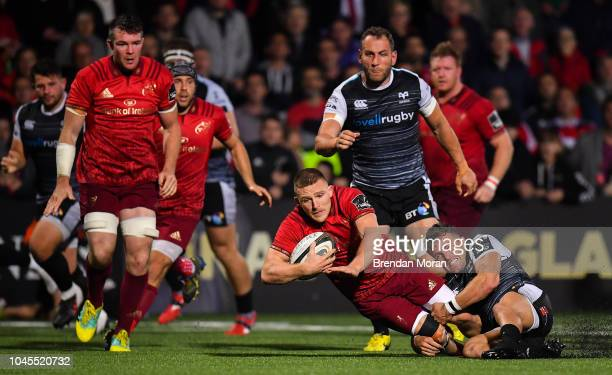 Cork Ireland 14 September 2018 Andrew Conway of Munster is tackled by Luke Morgan of Ospreys during the Guinness PRO14 Round 3 match between Munster...