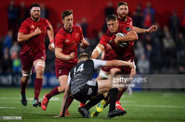 Cork Ireland 14 September 2018 Dan Goggin of Munster is tackled by Tom Williams of Ospreys during the Guinness PRO14 Round 3 match between Munster...