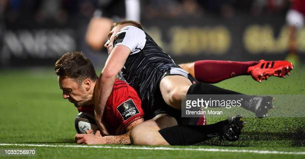 Cork Ireland 14 September 2018 Darren Sweetnam of Munster goes over to score his side's seventh try despite the tackle of Tom Williams of Ospreys...