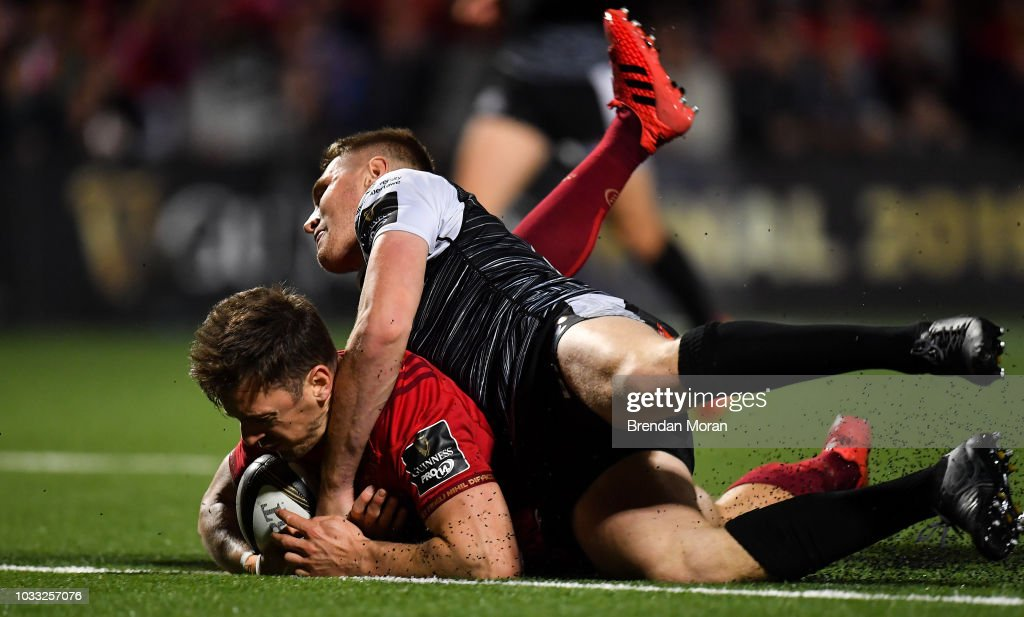 Cork , Ireland - 14 September 2018; Darren Sweetnam of Munster goes over to score his side's seventh try despite the tackle of Tom Williams of Ospreys during the Guinness PRO14 Round 3 match between Munster and Ospreys at Irish Independent Park in Cork.