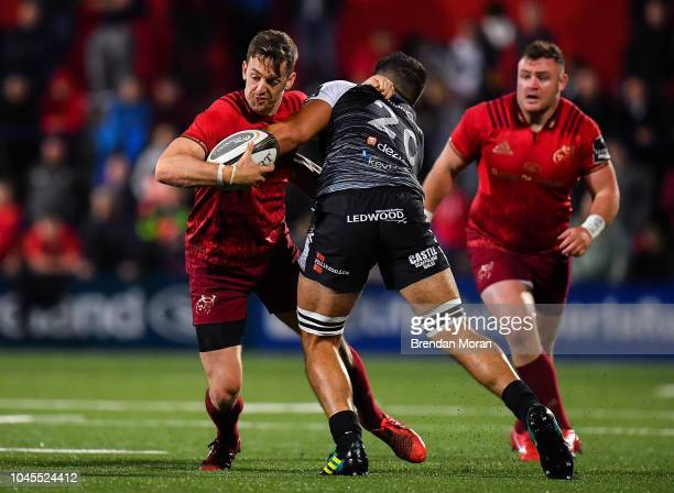 Cork Ireland 14 September 2018 Darren Sweetnam of Munster is tackled by Guido Volpi of Ospreys during the Guinness PRO14 Round 3 match between...