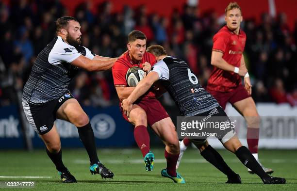 Cork Ireland 14 September 2018 Ian Keatley of Munster is tackled by Alex Jeffries and Olly Cracknell of Ospreys during the Guinness PRO14 Round 3...