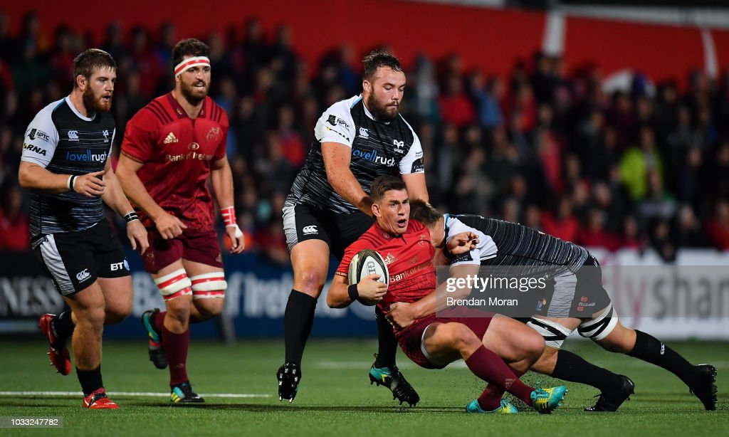 Cork , Ireland - 14 September 2018; Ian Keatley of Munster is tackled by Alex Jeffries and Olly Cracknell of Ospreys during the Guinness PRO14 Round 3 match between Munster and Ospreys at Irish Independent Park in Cork.