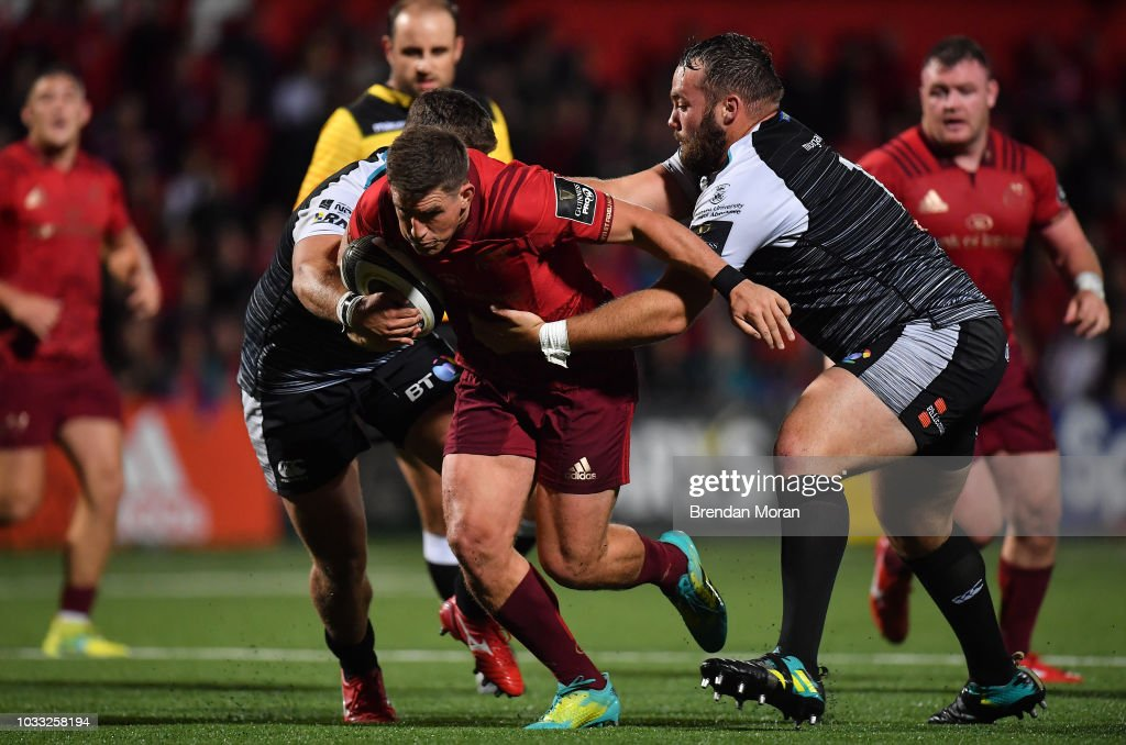 Cork , Ireland - 14 September 2018; Ian Keatley of Munster is tackled by Morgan Morris and Alex Jeffries of Ospreys during the Guinness PRO14 Round 3 match between Munster and Ospreys at Irish Independent Park in Cork.