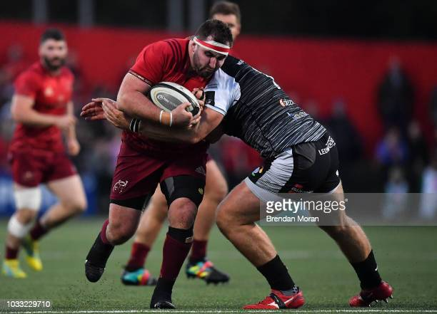 Cork Ireland 14 September 2018 James Cronin of Munster is tackled by Rhodri Jones of Ospreys during the Guinness PRO14 Round 3 match between Munster...