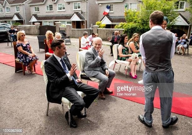 Cork , Ireland - 16 June 2020; Guests offer each other the sign of peace at the ceremony of Terence Lenihan and Tara Leguilloux during their COVID-19...